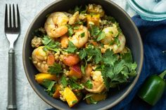 Who knew shrimp and peach could form a match made in flavor heaven? In these healthy rice bowls, tender, juicy shrimp meets succulent peach slices.