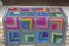 Colorful Hug baby blanket, by Annette Petavy - very pretty!  Simple mitered-corner pattern is free on Ravelry ~ http://www.ravelry.com/patterns/library/rainbow-collection---mitered-corner-pillow