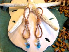 Natural very soft leather has been adorned with Czech Turquoise AB Crystal Drop and has Sterling Silver ear wires.