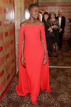 Lupita Nyong'o in Paul Andrew's custom red Zewnadia pump [Photo by Getty Images]