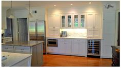 Feeko- After. Shaker style cabinets in BM White dove, 4 piece crown moldings, decorative side panel moldings, fridge box, appliance built ins, extra storage cabinets, custom glass doors #GreenKitchensUSA