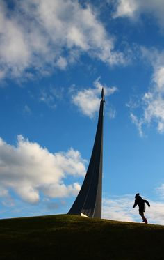 """This kid """"ruined"""" my picture at the Monument of the Conquerors of Space in Moscow #travel #photography #nature #photo #vacation #photooftheday #adventure #landscape"""