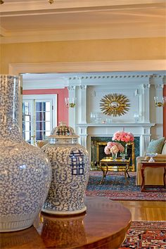 Buttery walls in entry, ornate mouldings, rugs, blue and white, brass and gilt accents - Anita Clark