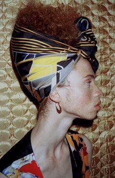 Scarf by Hermès; printed waistcoat by Vivienne Westwood; earrings stylist's own