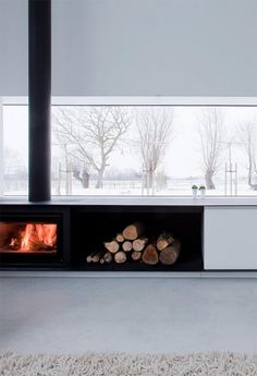 Looking for a new home? Check out our curated selection of estates on Aestate. Wood Burner Fireplace, Home Fireplace, Modern Fireplace, Fireplaces, Fireplace Feature Wall, Fireplace Surrounds, Freestanding Fireplace, Scandinavian Home, Home Living Room