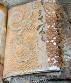 gorgeous journal pages with old fabrics and lace -- lots more pics if you follow the link to the site.