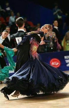 I would love to dance lead with this gown, the depth of petticoats is sensuous to sight and touch as they fold around and away.