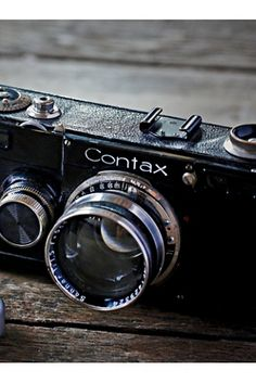 Vintage Loves Contax Camera | Free people Finished in black enamel with white lettering, this is a rare and wonderful example of the CONTAX  1(d), manufactured by Zeiss Ikon in Germany, Circa 1935.