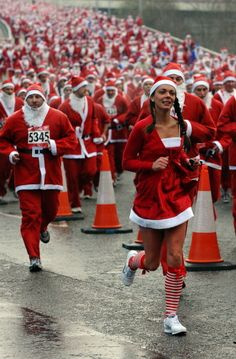 Runners dress as Santa Claus take part in the 2010 Santa Dash in Liverpool, north-west England, on December 5, 2010. The annual race sees thousands of competitors run the 5km course through the streets of the city center.