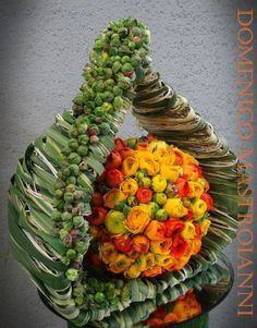 I find the divinity of Lord Ganesha in this floral design.  For mesmerizing designs go to www.spring-blossoms.com
