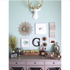 Such a beautiful gallery wall display in @lindsss11's home! Love that wall color!   #nearanddeer #fauxtaxidermy #homedecor #interiordesign #interiors #deer #fauxdeerhead #gallerywall #art #deerhead #walldecor #livingroom