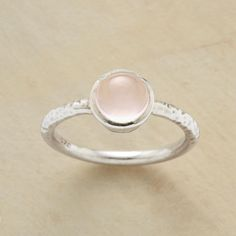 ROSE QUARTZ RING--The irregularities of hand hammering atop the band accentuate the pink perfection of our rose quartz cabochon ring. A Sundance exclusive in sterling silver. Whole sizes 5 to 9.