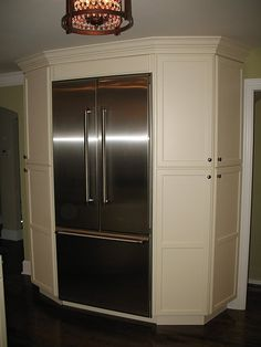 pantry cabinets around refrigerator- this is such a great idea.  Normally the space around the refrigerator is wasted.