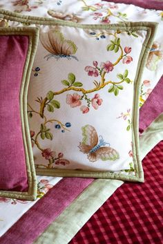 Pierre Frey Fabric..custom Pillows. A great added touch would be small tassels or a fringe.