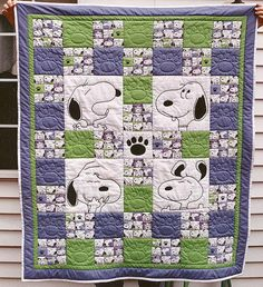 Quilting: Snoopy Quilt. Wonderful thematic quilt with snoopy. Very careful cutting to get the fussy cut squares just right.  Love the larger embroidered blocks. I wonder if something like this could be done in a superhero theme.
