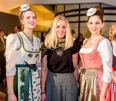 Gössl designer Maria Oberfrank reworked Augarten porcelain patterns for flower embroideries on clothing. fig. from left: The green-white festive dirndl shows flower embroideries and prints inspired by Augarten's 'Maria Theresia' porcelain decoration. In the middle, Maria Oberfrank, the designer of the Gössl Augarten Collection at the catwalk presentation on 9 March 2017 at Augarten Porcelain Manufactory in Vienna. The dirndl dress right shows... Photo: © Christian Dusek.