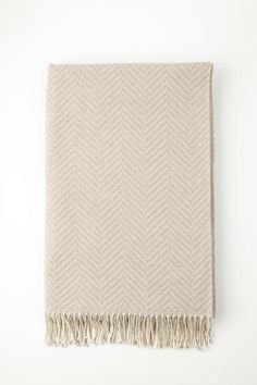 """Beautifully soft herringbone throw in extra fine merino wool in soft shades of light brown & white - made in Scotland by Johnstons of Elgin. Woven in Elgin, Scotland. Home Interiors - Plains- Luxurious two-tone  herringbone throw in extra fine merino. Now in larger bed size, this lavish blanket adds subtle and pure refinement to any bedroom setting. Size: 230x150cm / 90.5x59"""" 100% Extra Fine Merino Wool Dry Clean Lifestyle 1: Headboard & Cushion in Fable Cloud. Throws (left ..."""