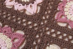 I really like this method of joining. It's easy, gives you more blanket for your money and, where these particular motifs are concerned, nicely breaks up the solid look of the brown borders.