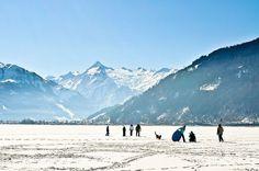 Go for a winter walk on the frozen Lake Zell next to the picturesque city of Zell am See, Austria Innsbruck, Salzburg, Ski Austria, Zell Am See, Winter Walk, Ski Resorts, Trip Planning, Winter Wonderland, Skiing
