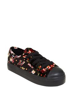 """Flowers make everything better. Take an entire garden with you on these floral fabric low top sneakers. The allover print is super soft.    Man-made materials  1"""" sole  Imported  Listed in women's sizes"""