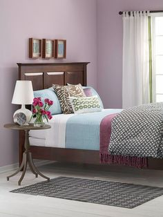 Cool palette...Rasberry and robin egg blue with the mauvey or heathery lavendar walls is a great combo I would not have picked.