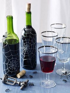 """5 Spooktacular Wine Bottle Crafts"" The spider web patterns on these are awesome looking... I want them. :)"