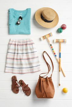 Croquet, anyone? Warm weather means cute skirts, strappy sandals and lawn games. Featured product includes: SONOMA Goods for Life striped linen skirt, faux-leather bucket bag, straw Panama hat, and gladiator sandals. Get dressed for spring at Kohl's.