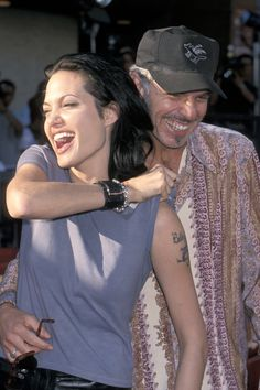 Giggling with then husband Billy Bob Thornton at the Gone in 60 Seconds premiere in June 2000.   - ELLE.com