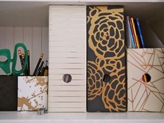 6 Unexpected Uses For Wallpaper: Upgrade your office supplies by adorning them with leftover wallpaper scraps.