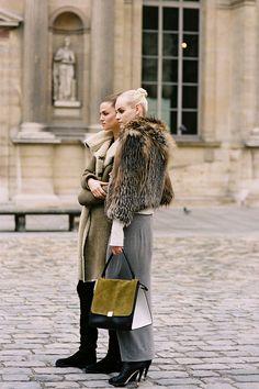 Ginta Lapina and Kasia Struss, after Louis Vuitton, Paris, March 2012.