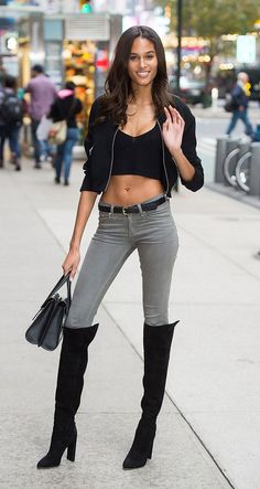 Victoria's Secret model Cindy Bruna looked SO good in a black crop top, skinny jeans, and over-the-knee boots on her way to a fitting before this year's fashion show - see more model off-duty outfits by clicking