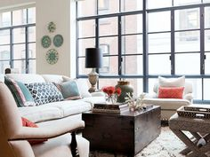 A New York apartment with floor to ceiling black trimmed windows features an eclectic design with a mix of patterns and just the right colors.- really like the black framed windows My Living Room, Home And Living, Living Spaces, Cozy Living, Living Area, Living Room Inspiration, Interior Inspiration, Home Interior, Interior Design