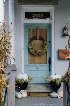 That's it im painting the brick on my house... oh and I love this fall porch look