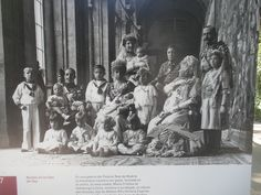 Maria Cristina, in her later years, wearing an unknown tiar and veil combination, surrounded by her extended family