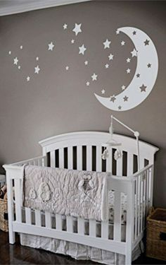 Adorable nursery! Love the moon and stars wall decal over the crib. Easy enough DIY nursery decorating idea!