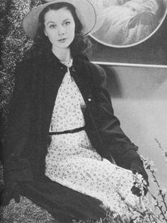 Vogue 1942. Vivien models a Molyneux star print dress and black coat.  photo Cecil Beaton