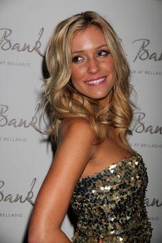 Kristin Cavallaris blonde, wavy hairstyle