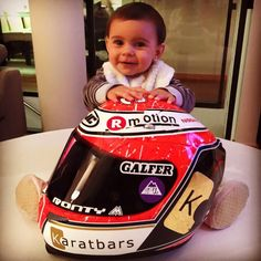 Ricky Cardus's son with his newly painted helmet with the Karatbars logo.