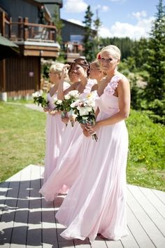 Beach wedding ... I love the bridesmaid dresses!
