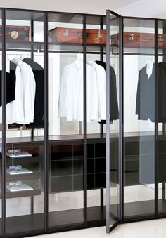 nice to see white wall against aluminium frame doors, ?.. with glass. less heavy than wood carcass of shelving units etc