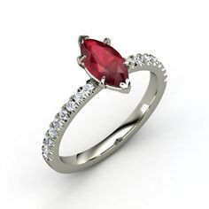 Love this cut. this looks like a ruby, but i prefer garnett, aquamarine, or emerald in this setting.