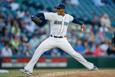 Roenis Elias Photos Photos - Starting pitcher Roenis Elias #29 of the Seattle Mariners pitches against the Tampa Bay Rays in the second inning at Safeco Field on June 4, 2015 in Seattle, Washington. - Tampa Bay Rays v Seattle Mariners