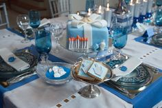 Stunning Hanukkah table with decorated dreidel cookies, favors and cake   #hanukkah #table