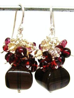 The birthstone of January is Garnet. I chose very clear smokey quartz, since big quality garnets were not available and adorned it with garnets in 4 different shades of red and a few citrine stones.