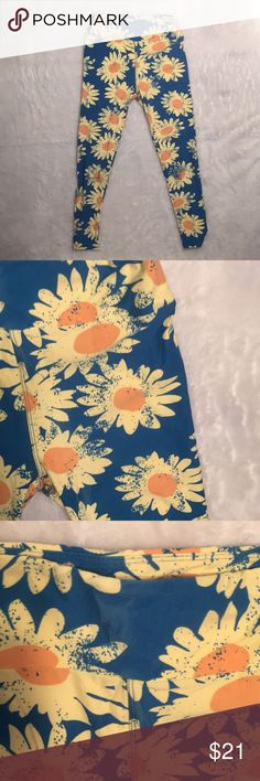 LuLaRoe sunflower Print leggings These are not only a cute print but they feel like butter.   They are OS LuLaRoe Pants Leggings