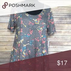 LuLaRoe Perfect T New with tags, printed LuLaRoe Perfect T. No trades but open to reasonable offers! LuLaRoe Tops