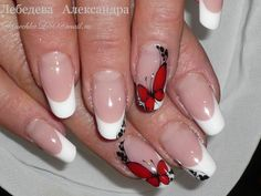 Nail art: red butterflies on French tips