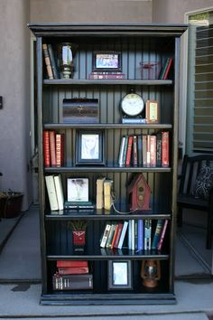 Doubletake Decor- holy moly. She made this from a boring, plain bookcase! She added crown molding and bead board. wow