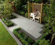 Reading a book on Eclipse Granite Paving.   We love how this garden uses darker paving to create a border for a sophisticated look!