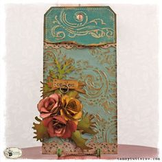"Tammy Tutterow's ""Everything's coming up roses"" tag found on Inspiration Journal blog from Inspiration Emporium.  I love the layered look of this distressed tag."